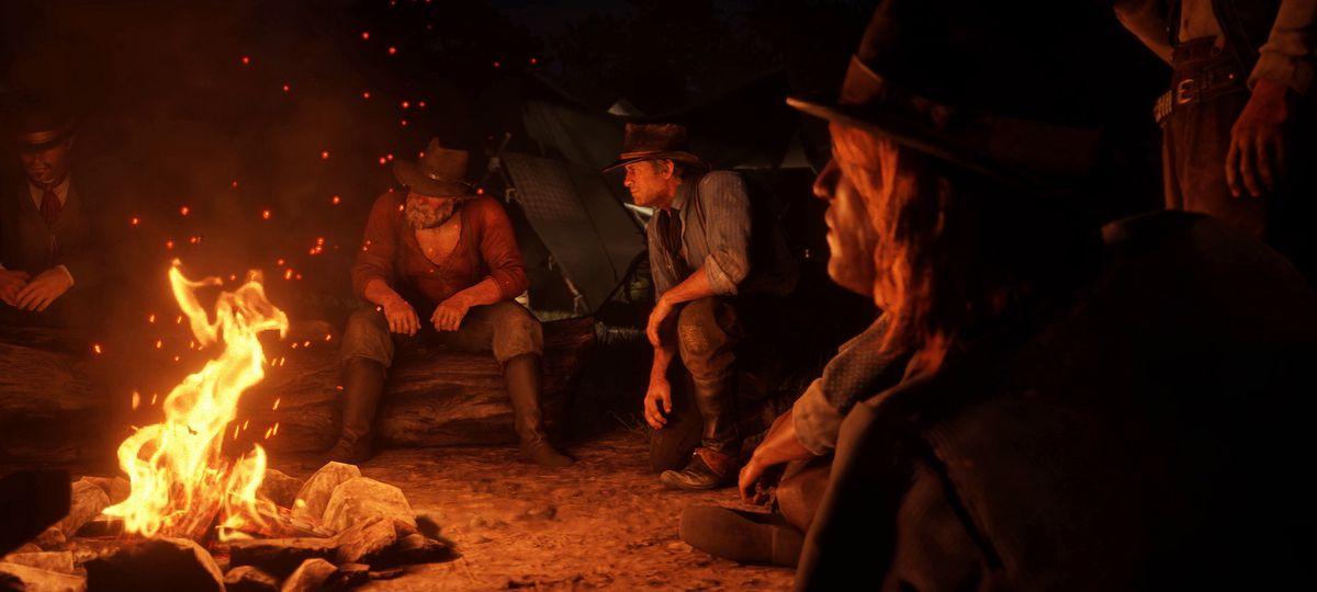 Red Dead Redemption 2 - the Van der Linde Gang by a campfire