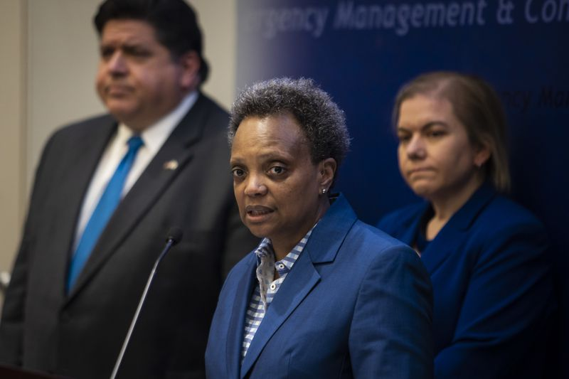 Mayor Lori Lightfoot, pictured at a news conference in March 2020 with Gov. J.B. Pritkzer and Chicago Public Health Commissioner Dr. Allison Arwady.