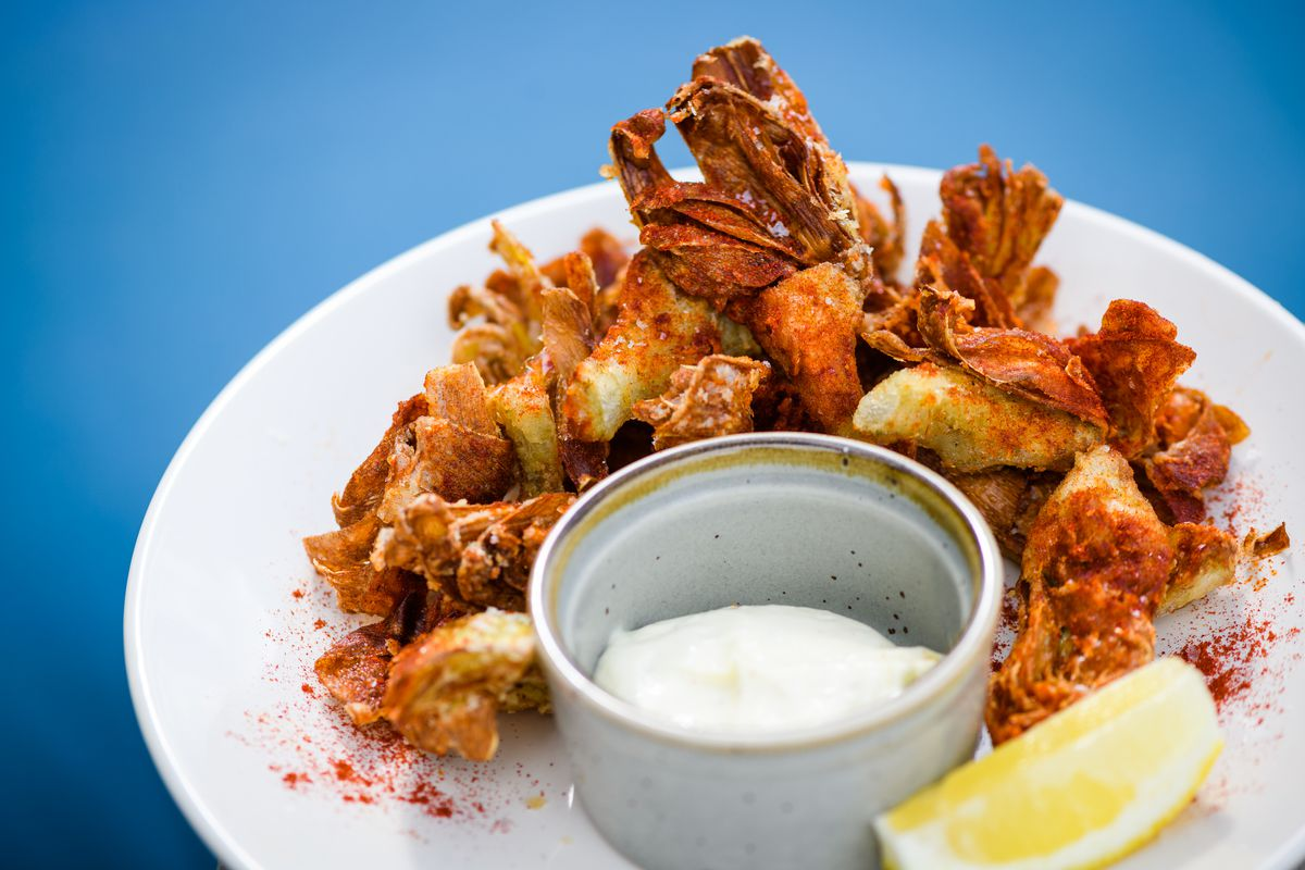 Artichokes sit on a white plate dusted with paprika at Lolo Pass