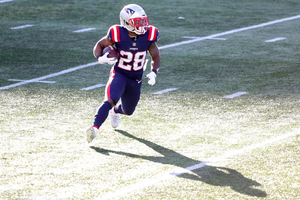 James White #28 of the New England Patriots rushes with the ball against the Arizona Cardinals at Gillette Stadium on November 29, 2020 in Foxborough, Massachusetts.