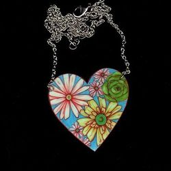 "Hand-drawn <a href=""http://birdqueendesigns.com/artwork/2998706_Heart_Necklace_in_Retro_Floral.html"">Heart Necklace</a>, $18 from BirdQueen Designs"
