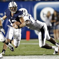 BYU's #13 Riley Nelson zigs and zags his way past USU players as BYU and Utah State play Friday, Sept. 30, 2011 at Lavell Edwards Stadium.