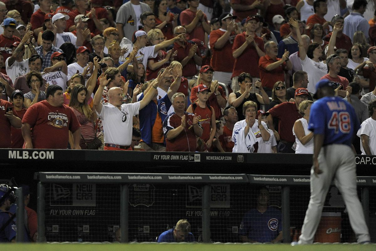 St. Louis, MO. USA; Chicago Cubs relief pitcher Rafael Dolis walks off the field as fans cheer after the St. Louis Cardinals scored 12 runs in the seventh inning at Busch Stadium. Credit: Jeff Curry-US PRESSWIRE