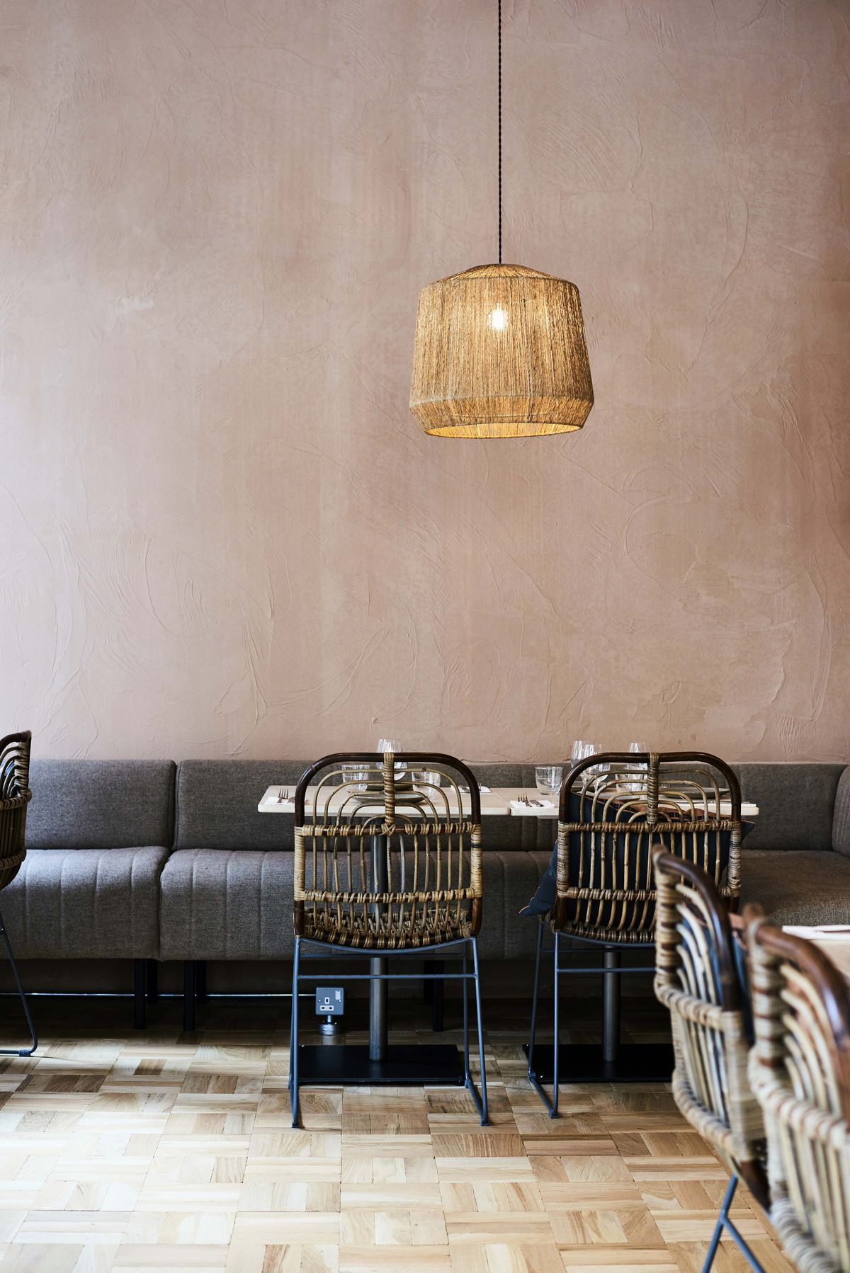 Sofa seating and wicker chairs at Caravan Coffee Roasters' new site in Fitzrovia, London