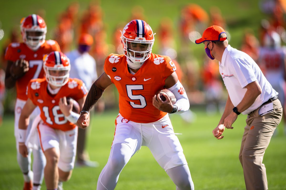 Clemson quarterback D.J. Uiagalelei (5) warms up with his team before their game against Syracuse at Memorial Stadium.
