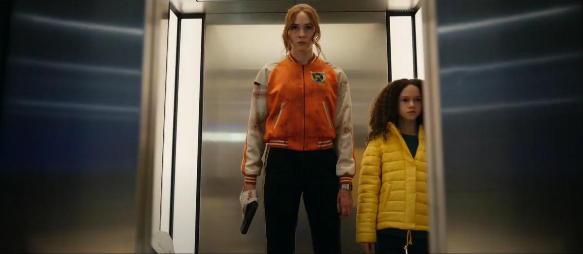 Karen Gillan in an elevator with a gun in Netflix's Gunpowder Milkshake