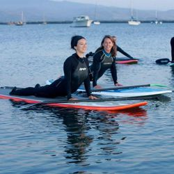 """<b>On Board Yoga—</b>If yoga on the boring old solid ground is feeling a bit too routine lately, <a href=""""http://onboardyoga.com"""">Islena Faircrest</a> teaches yoga on standup paddle boards, also known as SUPs, in the Pillar Point Harbor near Mavericks. Do"""