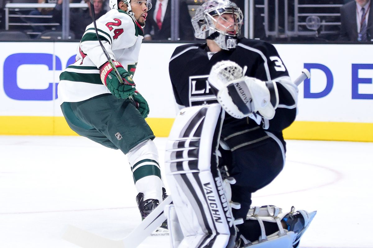 Matt Dumba and Jonathan Quick react as Jarret Stoll rips off his Wild jersey to reveal a Kings jersey.