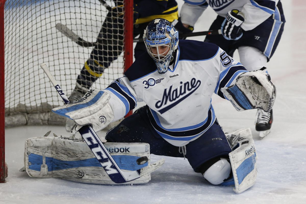 Maine senior goaltender Martin Ouellette makes one of his 29 saves in his team's 2-0 Hockey East playoff victory over Merrimack.