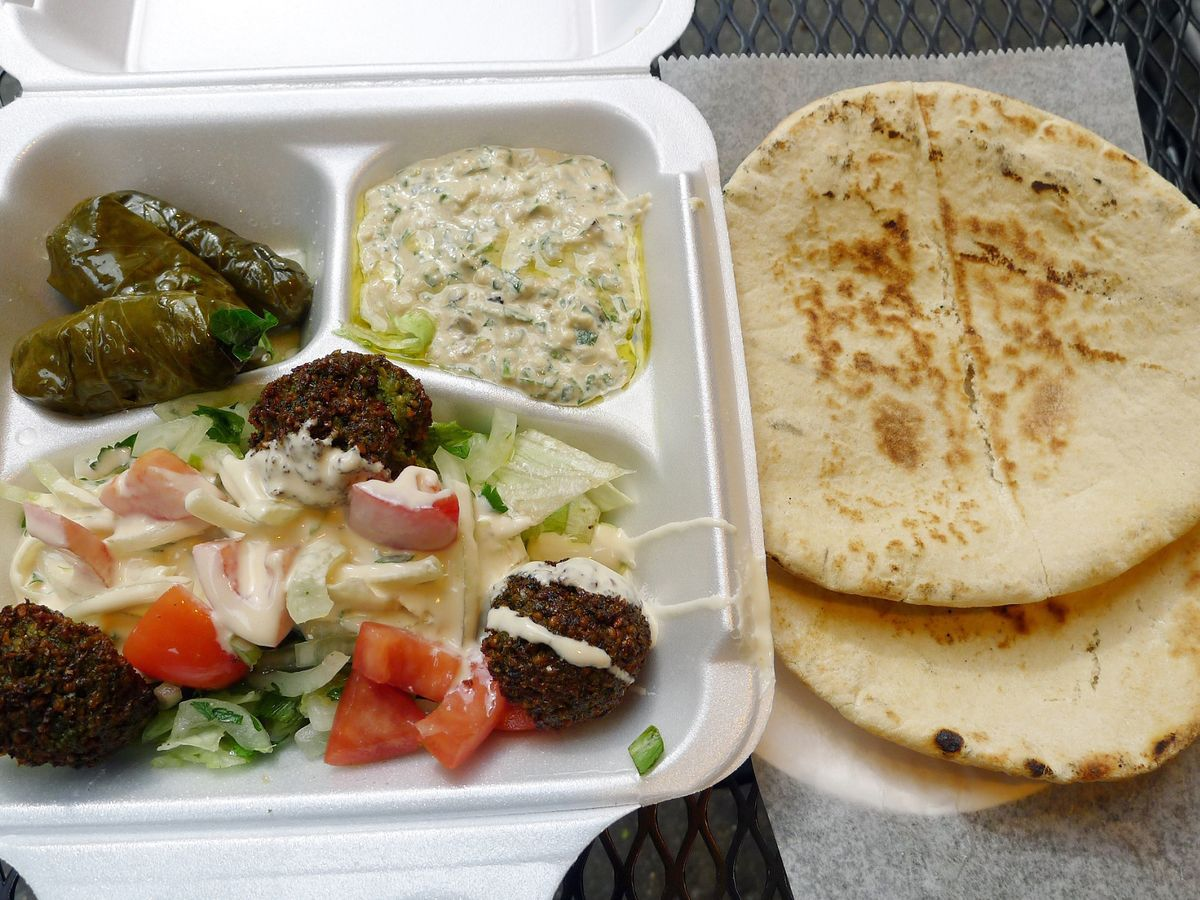 A styrofoam container full of delicious food from Mamoun's