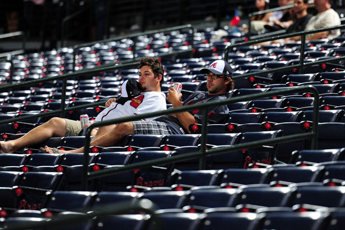 ATLANTA - SEPTEMBER 27: Fans of the Atlanta Braves linger in the stands after the game against the Philadelphia Phillies at Turner Field on September 27, 2011 in Atlanta, Georgia. (Photo by Scott Cunningham/Getty Images)