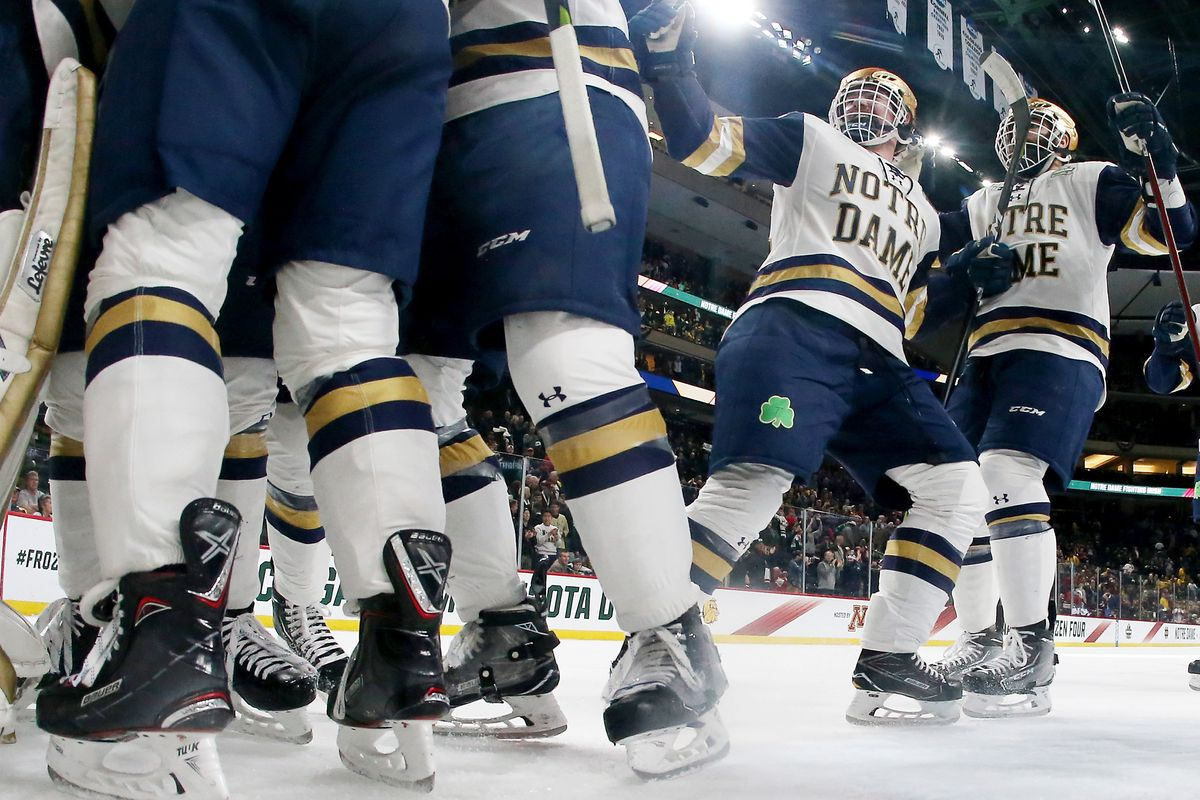 2018 NCAA Division I Men's Hockey Championships - SemifinalsST PAUL, MN - APRIL 05: The Notre Dame Fighting Irish celebrate the 4-3 win over the Michigan Wolverines during the semifinals of the 2018 NCAA Division I Men's Hockey Championships on Apri