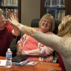 """Olympic silver medalist Noelle Pikus-Pace high-fives Dean Wheelwright during a small group discussion about Pace's new book, """"Focused: Keeping Your Life on Track, One Choice at a Time,"""" at Deseret Book corporate headquarters, Tuesday, Sept. 9, 2014."""