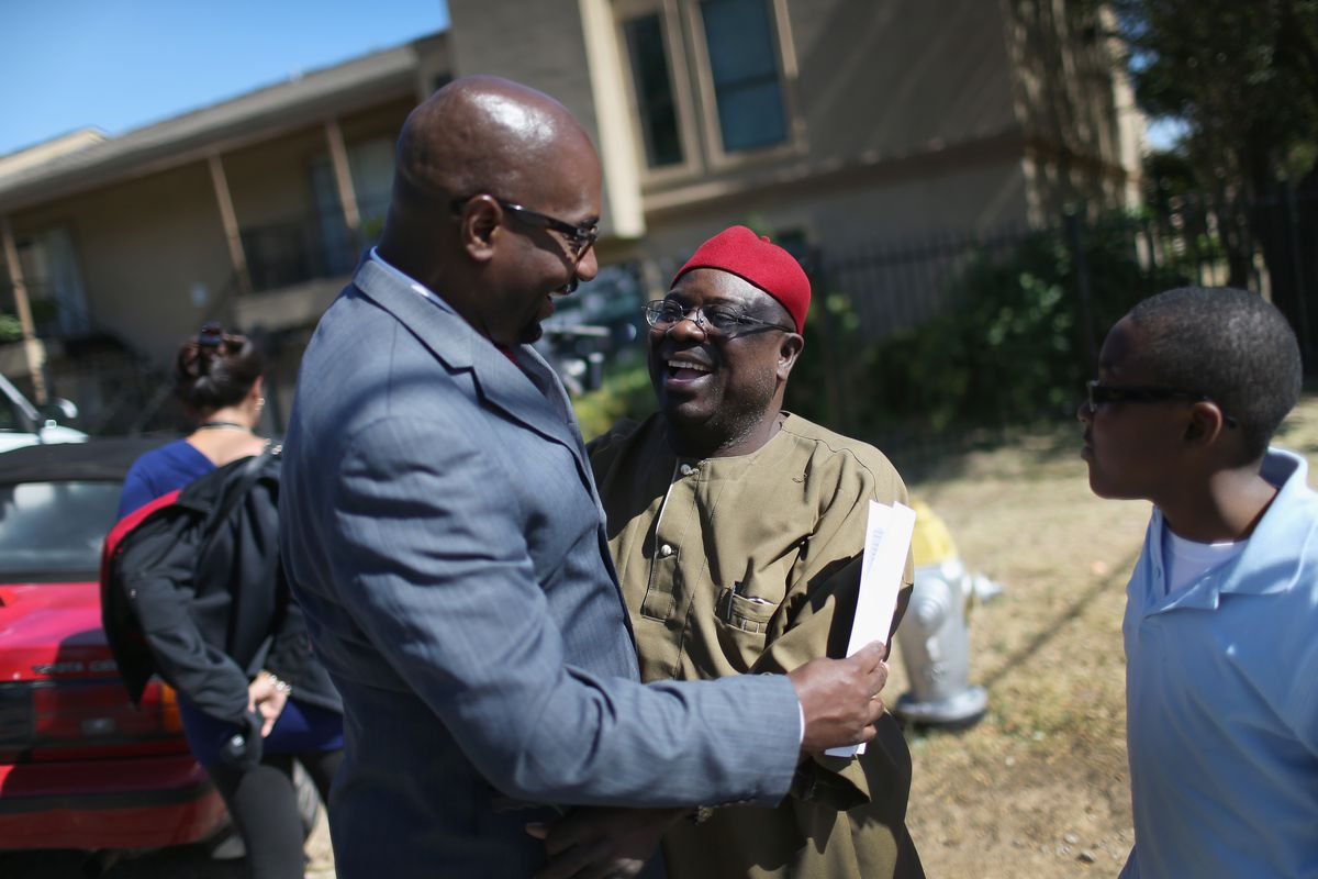 October 4 - Congressional candidate Eric Williams hugs those outside the Ivy Apartment complex where Thomas Duncan, the confirmed Ebola patient, had stayed.