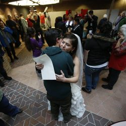 Jax and Heather Collins get married at the Salt Lake County clerk's office on Monday, December 23, 2013.