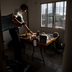Elder Tanner McKee, a missionary for The Church of Jesus Christ of Latter-day Saints, packs his belongings at his home in Paranaguá, Brazil, before transferring to a new area of the Curitiba South mission on Monday, June 3, 2019.