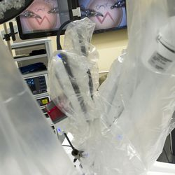 A da Vinci Xi surgery robot sutures a practice incision at St. Mark's Hospital in Salt Lake City on Friday, Dec. 16, 2016. The robot mimics a surgeon's hand movements but with a wider range of motion using robotic arms, allowing physicians to perform complex dissections or reconstructions with a much smaller incision. As a result, patients experience less trauma, reduced pain, faster recovery times and minimal scarring.