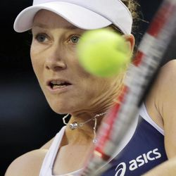 Samantha Stosur of Australia returns the ball against Maria Sharapova of Russia during the quarterfinal at the Pan Pacific Open Tennis in Tokyo,Thursday, Sept. 27, 2012.