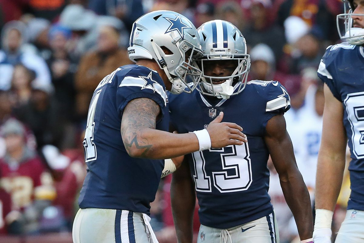 Dallas Cowboys quarterback Dak Prescott celebrates with Cowboys wide receiver Michael Gallup after combining on a touchdown against Washington in the second quarter at FedEx Field.