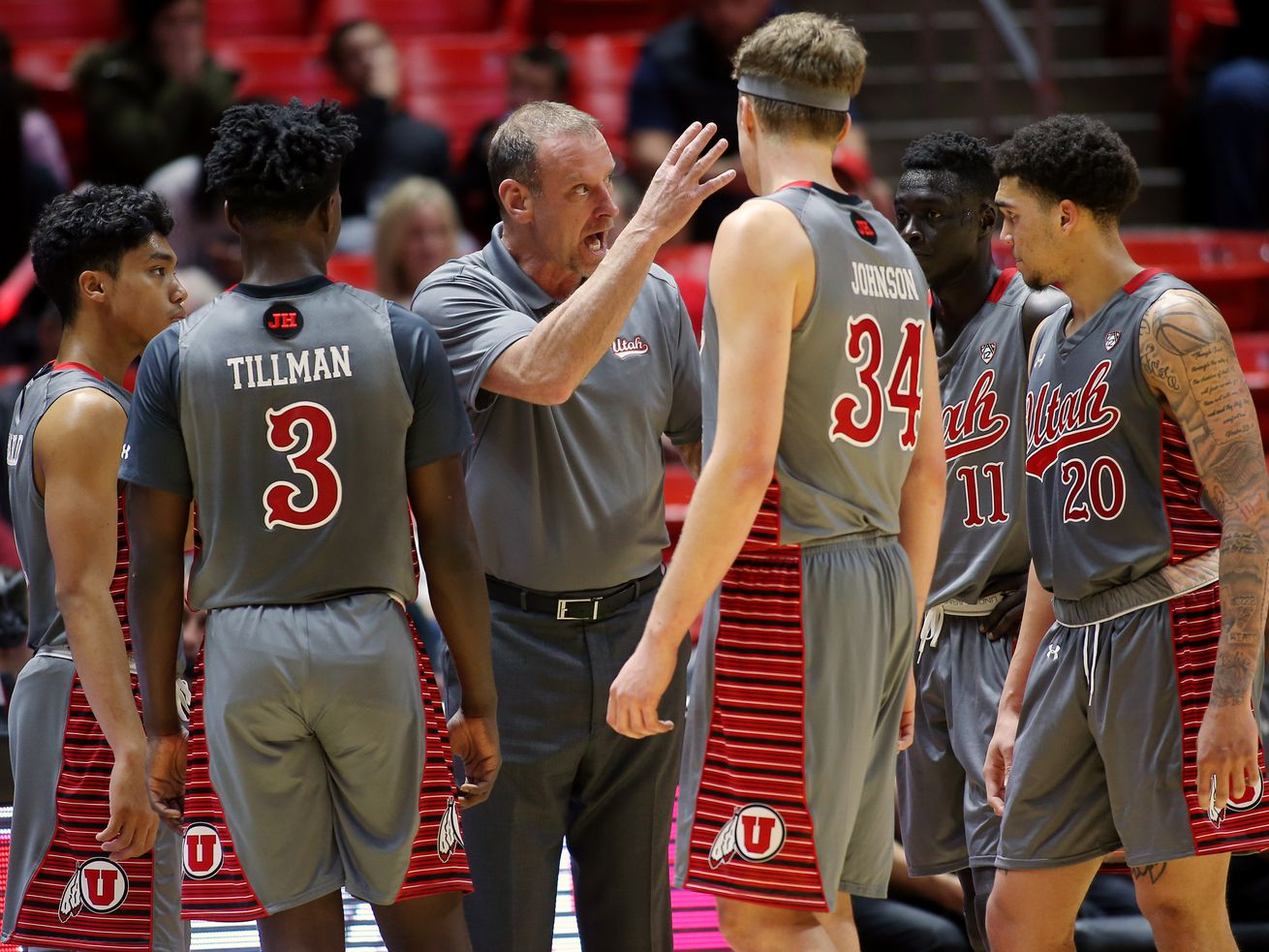 Utah basketball coach Larry Krystkowiak talks with his players during a timeout as Utah and Colorado play in the Huntsman Center in Salt Lake City on Sunday, Jan. 20, 2019.