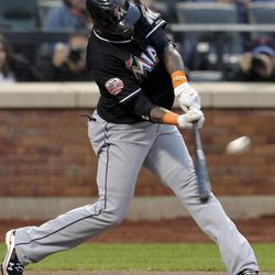 Miami Marlins' Jose Reyes flies out during the first inning of a baseball game against the New York Mets on Tuesday, April 24, 2012, at Citi Field in New York.