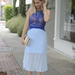 """Emily of <a href=""""http://cupcakesandcashmere.com""""target=""""_blank""""> Cupcakes and Cashmere</a> is wearing a Three Floor dress, Christian Louboutin heels and a vintage clutch."""