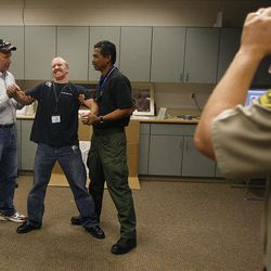 Utah County sheriff's deputy Jared Warner feels the shock from a Taser as it is fired during practice.