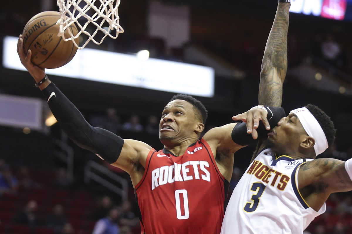 Houston Rockets guard Russell Westbrook shoots against Denver Nuggets forward Torrey Craig in the first quarter at Toyota Center.