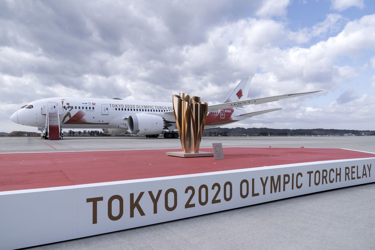 The cauldron is seen on the stage in front of the aircraft transporting the Olympic flame parked at the Japan Air Self-Defense Force Matsushima Air Base ahead of the Tokyo 2020 Olympic Games Flame Arrival Ceremony on March 20, 2020 in Higashimatsushima, Miyagi, Japan.