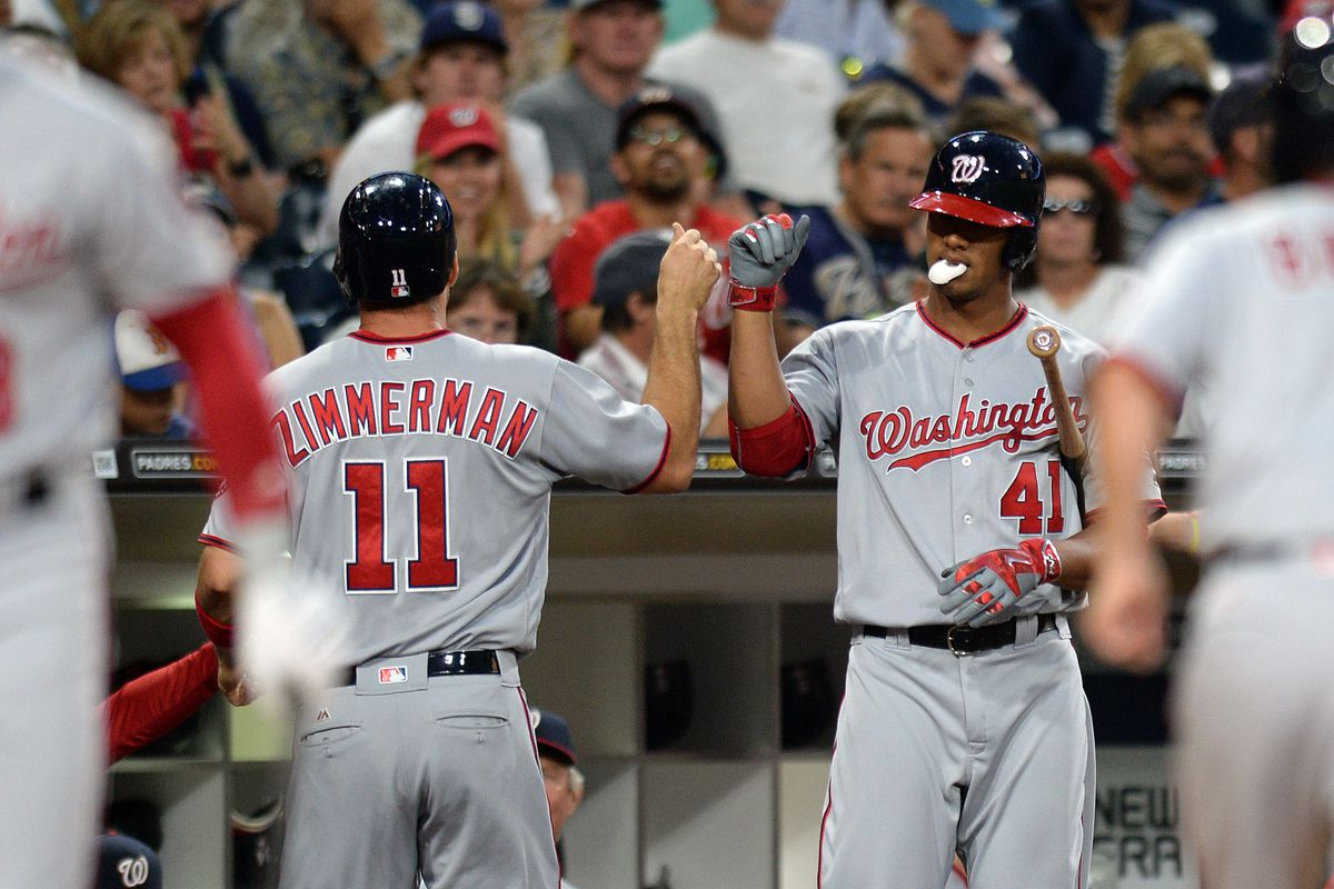 Washington Nationals first baseman Ryan Zimmerman is congratulated by starting pitcher Joe Ross after scoring during the second inning against the San Diego Padres at Petco Park.