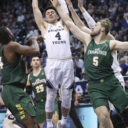 Brigham Young Cougars guard Alex Barcello (4) grabs a rebound around the San Francisco Dons in Provo on Saturday, Feb. 8, 2020.