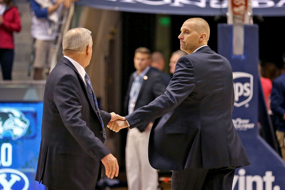 BYU coach Dave Rose, left, shakes hands with UVU coach Mark Pope after game Friday, Nov. 13, 2015, in Provo. Pope is among the candidates who may replace Rose at BYU.