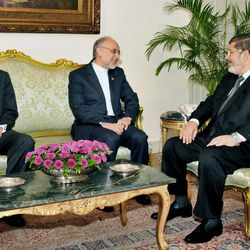 In this image released by the Egyptian President, Egyptian President Mohammed Morsi, right, meets with Iranian Foreign Minister Ali Akbar Salehi, center, and Egyptian Foreign Minister Mohammed Kamel Amr, at the Presidential Palace in Cairo, Egypt, Tuesday, Sept. 18, 2012.