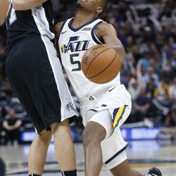 Utah Jazz guard Rodney Hood (5) drives on San Antonio Spurs center Joffrey Lauvergne (77) in Salt Lake City on Thursday, Dec. 21, 2017. Utah won 100-89.