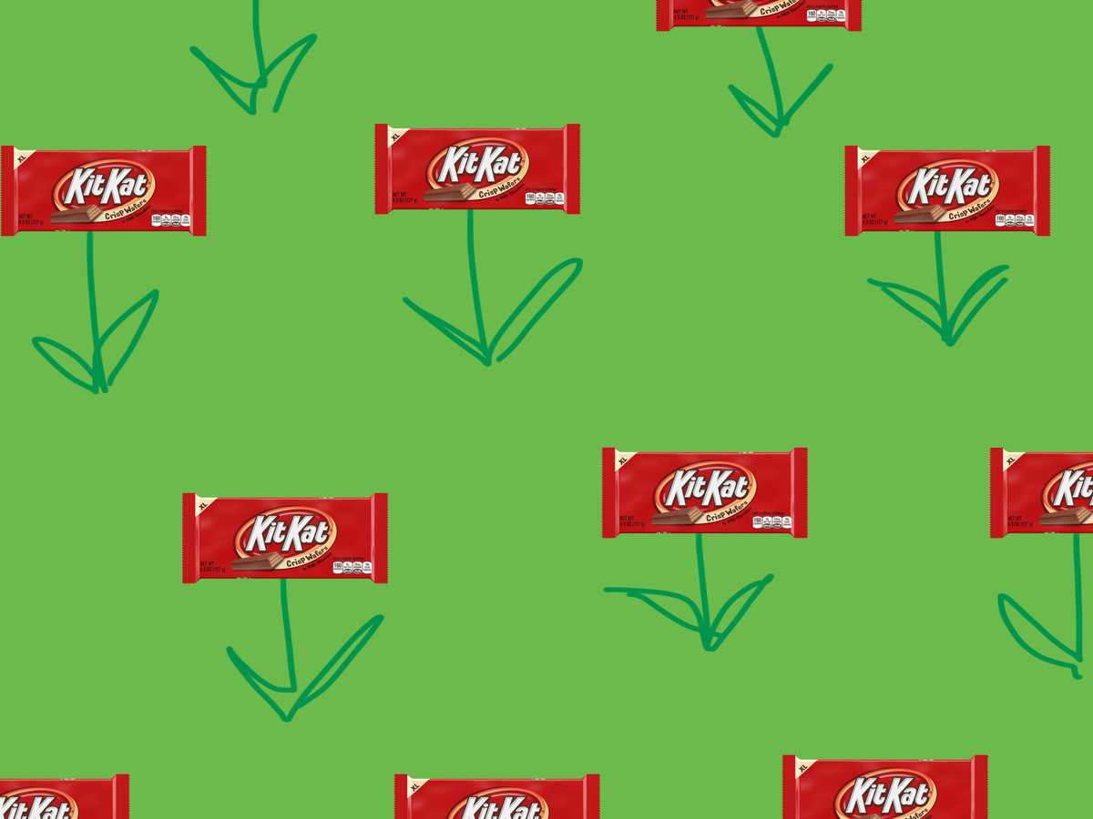 A bad illustration of green grass with Kit Kats on flower stems emerging from the ground.