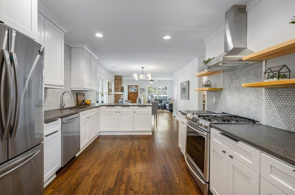 A long gray kitchen with a white ceiling.