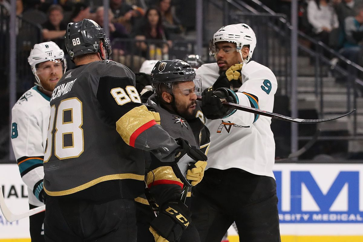 GLENDALE, NV - APRIL 26: Evander Kane #9 of the San Jose Sharks corss-checks Pierre-Edouard Bellemare #41 of the Vegas Golden Knights in the third period Game One of the Western Conference Second Round during the 2018 NHL Stanley Cup Playoffs at T-Mobile