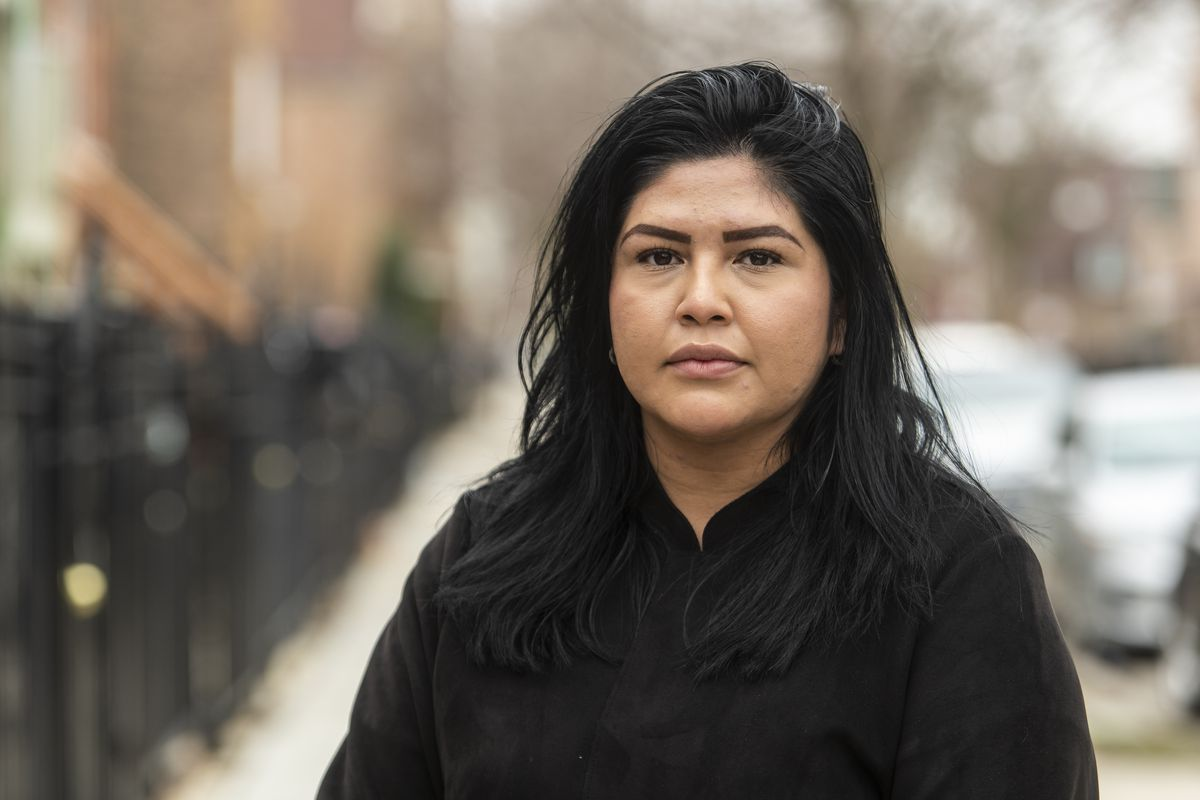 Jadhira Sanchez, Senior Manager of Community Health with Enlace Chicago, stands in front of her home, Friday, March 26, 2021.