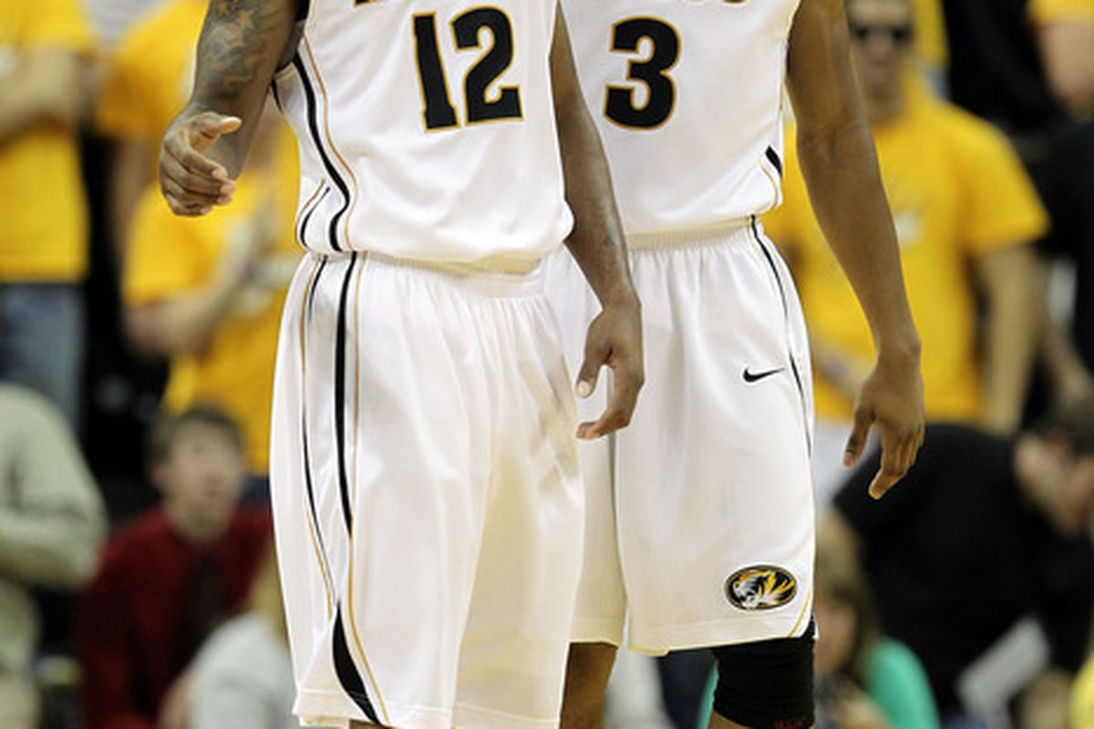 COLUMBIA, MO - NOVEMBER 17:  Marcus Denmon #12 and Matt Pressey #3 of the Missouri Tigers react after scoring during the game the Niagara Purple Eagles on November 17, 2011 at Mizzou Arena in Columbia, Missouri.  (Photo by Jamie Squire/Getty Images)