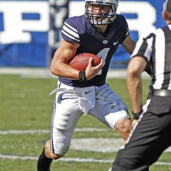 Brigham Young Cougars quarterback Taysom Hill (4)as Brigham Young University defeats Weber State University in football 45-6 Saturday, Sept. 8, 2012, in Provo, Utah.