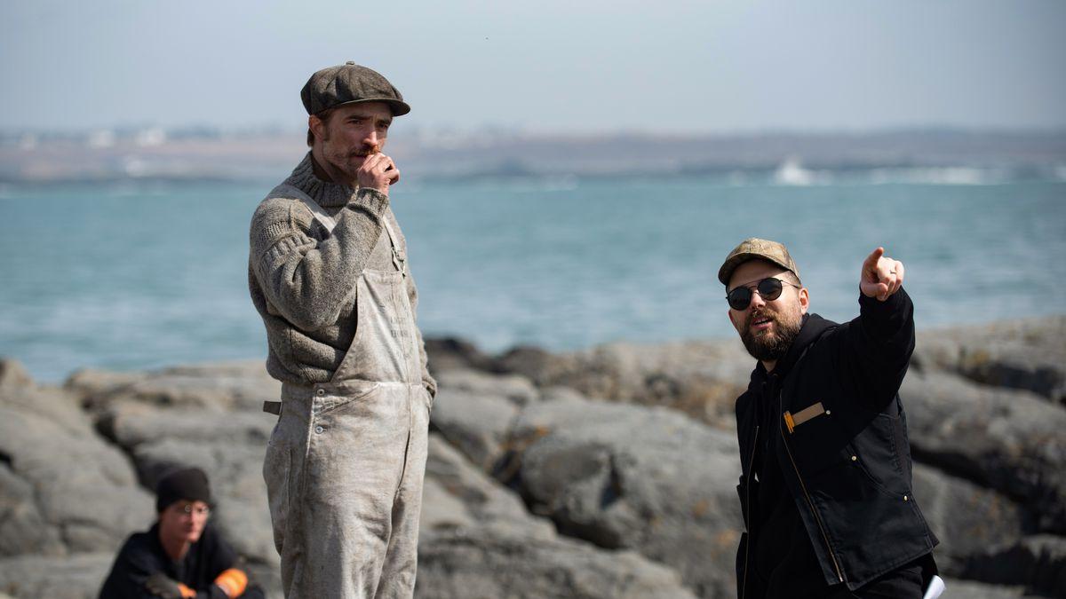 Eggers points as Pattinson looks on.