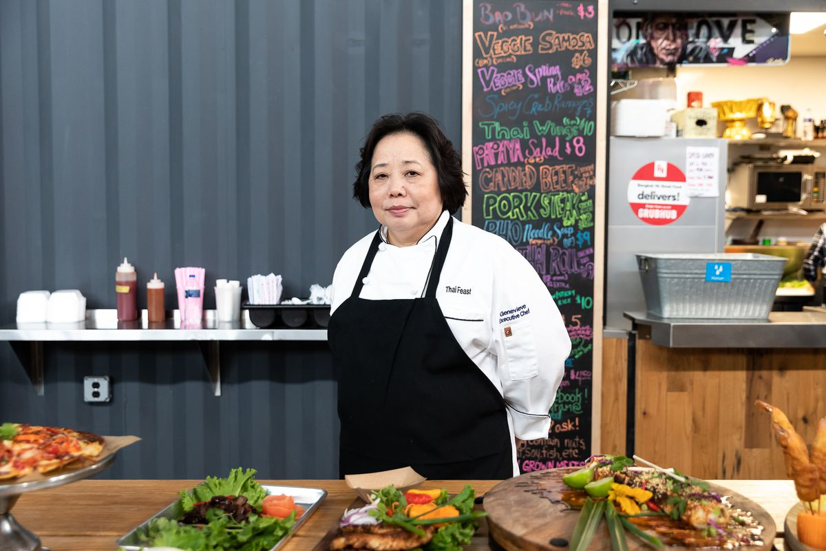 Chef Genevieve Vang stands in front of Bangkok 96 Street Food at Detroit Shipping Company.