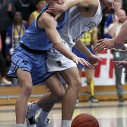 West Jordan's Austin Klingler, left, and gets Taylorsville's Steele Hess battle for the ball during boy's basketball game in Taylorsville on Tuesday, Jan. 28, 2020.