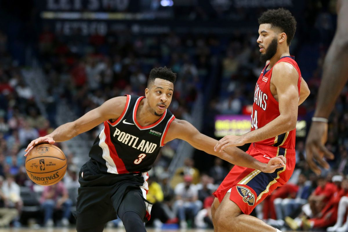Portland Trail Blazers guard C.J. McCollum controls the ball defended by New Orleans Pelicans guard Kenrich Williams in the second half at the Smoothie King Center.