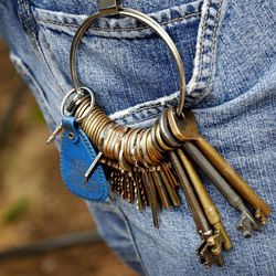 Myriad keys hand off a key ring on pants worn by Richard Wainscott, chief Mechanical Officer at the Museum of the American Railroad, Wednesday, Aug. 15, 2012 at Dallas' Fair Park. The Museum of the American Railroad is relocating from Fair Park to Frisco in the coming weeks.  The unprecedented move of such a wide array of trains has piqued the interest of railroad buffs around the globe. The one-of-a-kind collection spans the golden era of railroads from 1900 to 1970. Its roster of rolling stock comes from the West Coast, the East Coast and places in between. Each of the 40 pieces carries with it a bit of history.