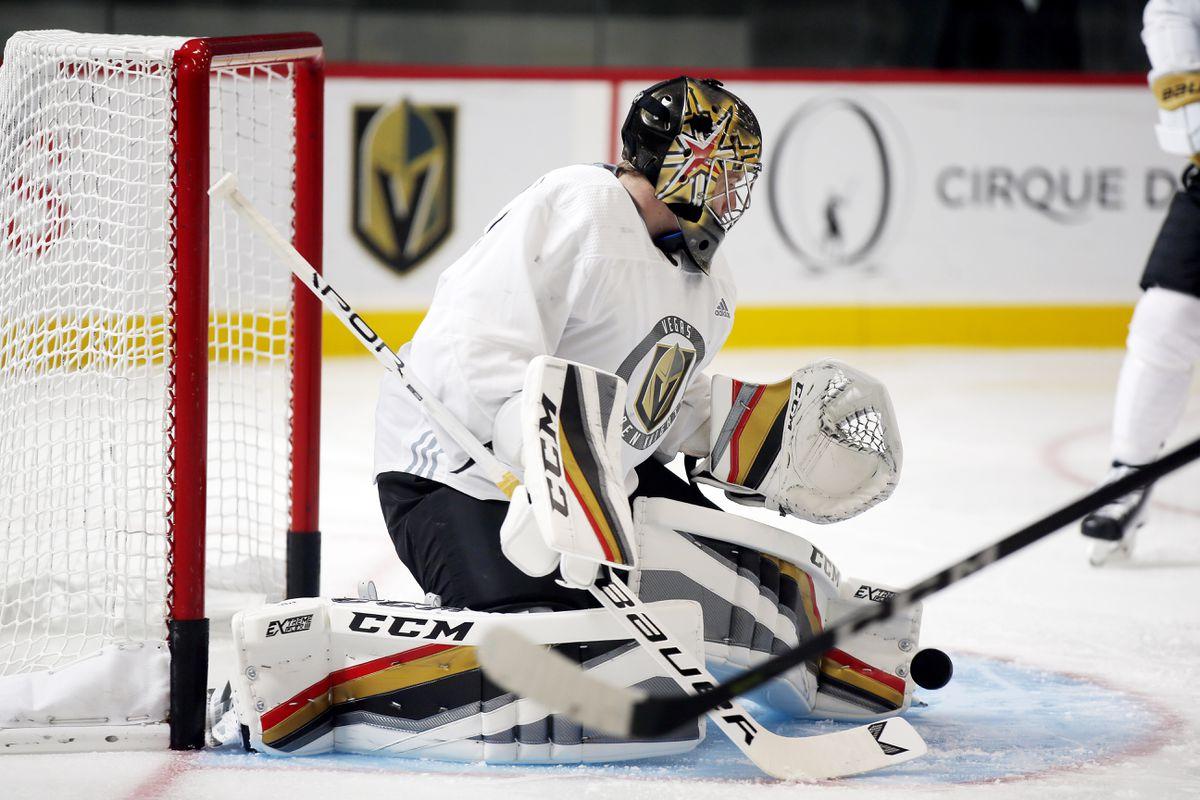 A Vegas Golden Knights goalie blocks a shot during practice