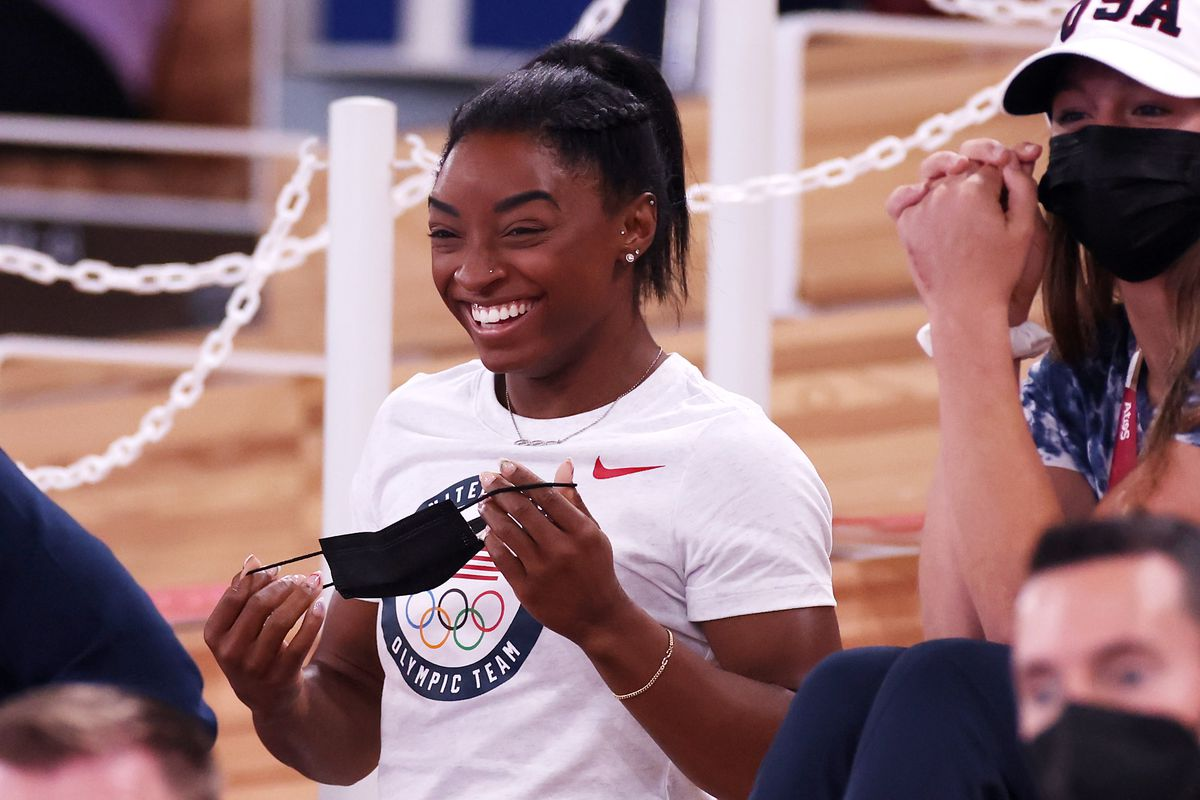 Simone Biles of Team United States smiles during the Women's Uneven Bars Final on day nine of the Tokyo 2020 Olympic Games at Ariake Gymnastics Centre on August 01, 2021 in Tokyo, Japan.