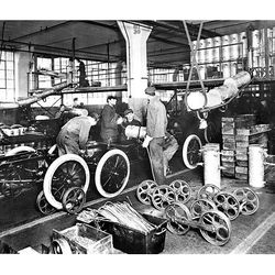 A moving assembly line at a Ford plant in 1913 made cars more affordable for average Americans.