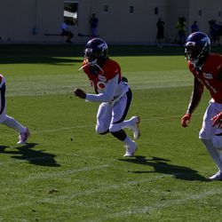 Broncos CBs Chris Harris Jr. (left), Bradley Roby (middle), and Aqib Talib (right) move together during drills at training camp.