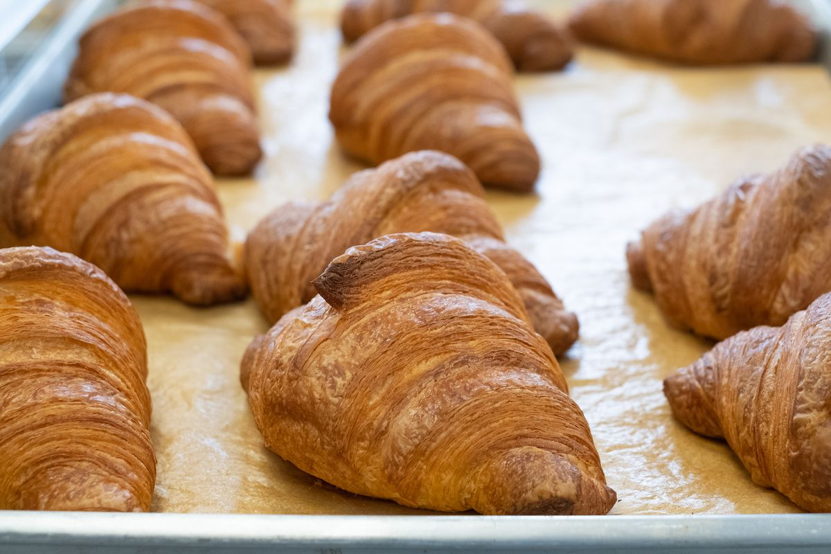 A sheet pan full of croissants